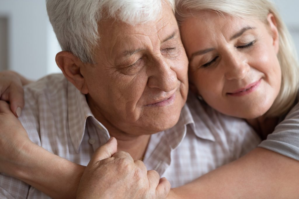 An older man and his daughter share a tender, yet somber, embrace. At DaySpring, our senior care services are supported by over 30 years of experience.